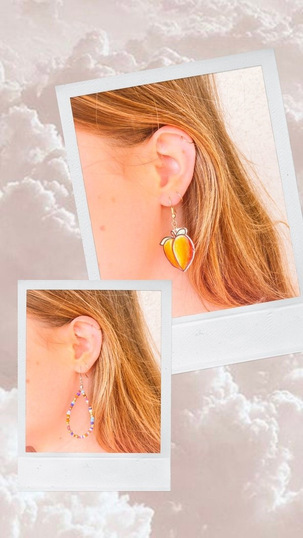 This is an image of a girl wearing peach earrings and beaded earrings