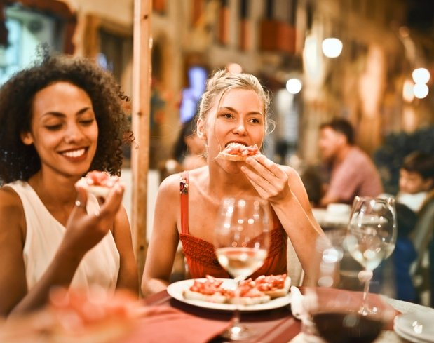women eating bruschetta