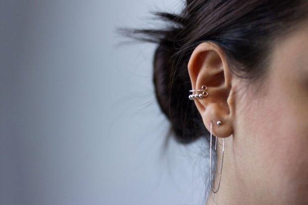 Silver ear piercing in ear