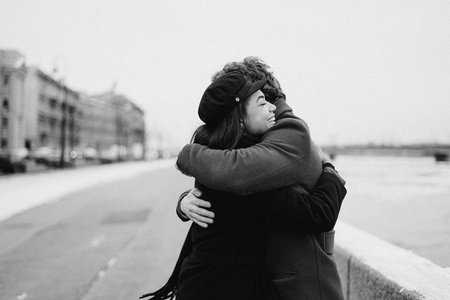 man and woman hugging and smiling