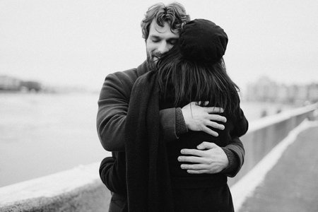 man and woman hugging