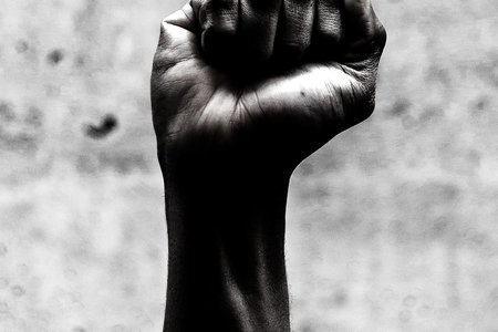 Black and white photo of a fist in the air