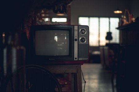 Dark room with retro tv