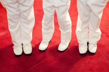 three boys standing on red carpet