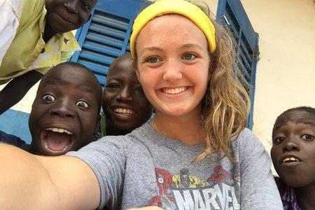 Girl talking selfie with children