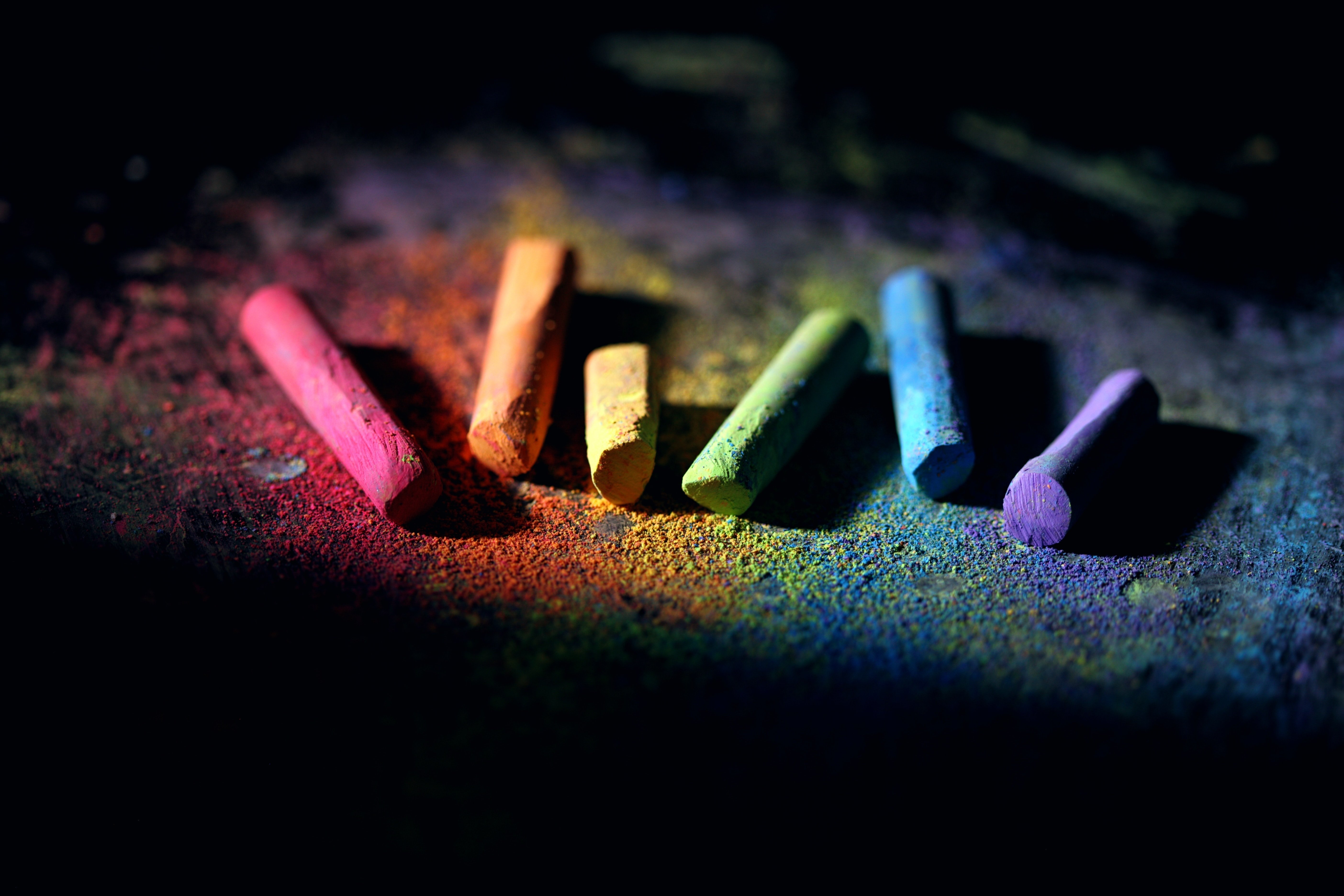 Rainbow chalk on black