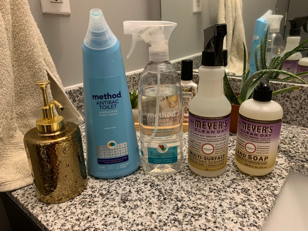 variety of cleaning products on bathroom sink