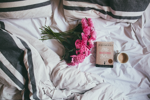flowers and book on bed