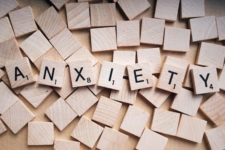 "A photo of scrabble words assembled to spell ""anxiety"""