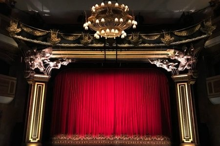 Red curtain in big theatre