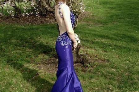 Woman in prom dress outdoors