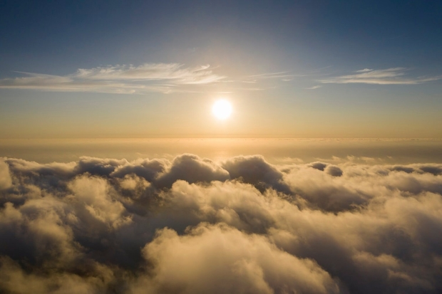 A bird's eye view of beautiful clouds and the sun
