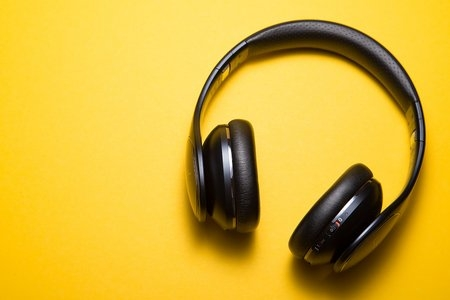 yellow background with headphones