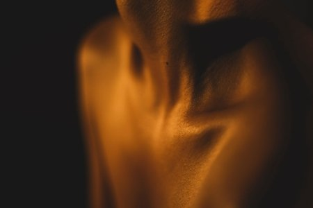 Zoomed in photo of a person's neck and clavicle area