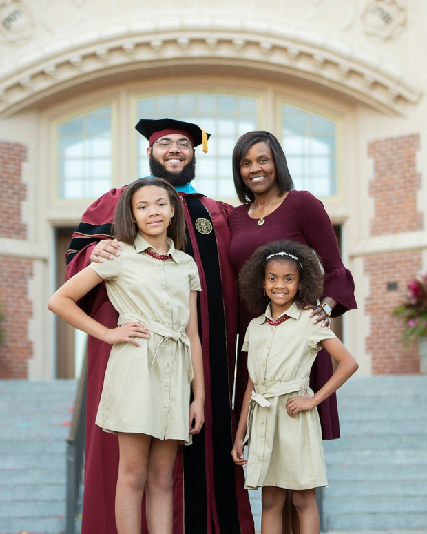 Dr. Starke's family in front of Westcott building