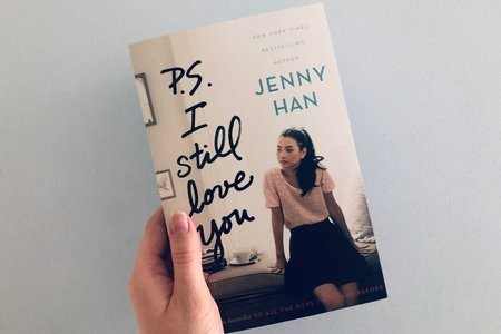 "Someone holding a copy of the book ""P.S. I Still Love You"""