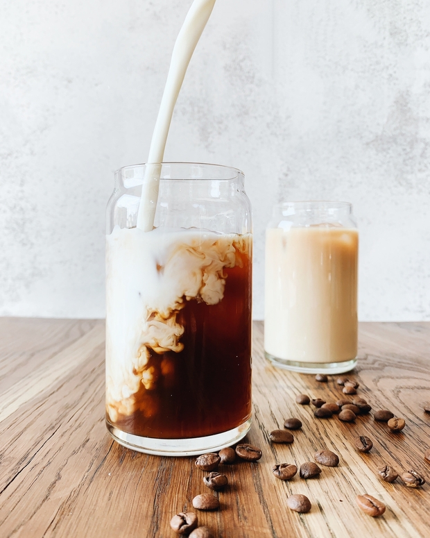 clear glass with coffee and milk