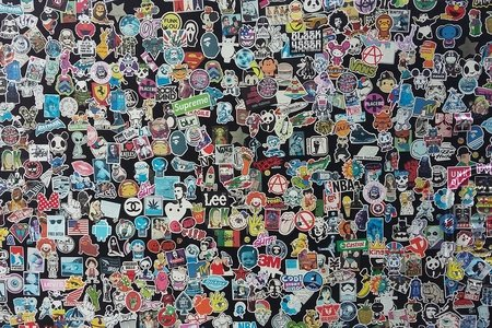 a bunch of stickers on a wall