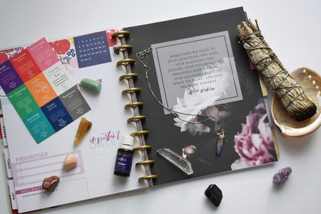 A sage smudge stick and a planner