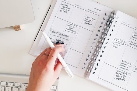 girl using planner to check off events