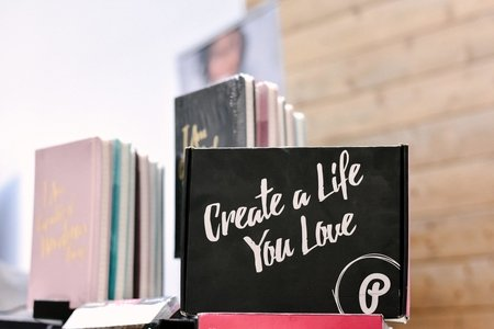 "Notebook with ""create a life you love"" written on it"