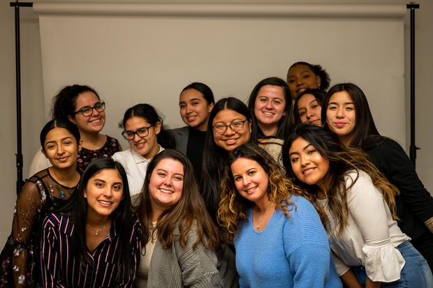 A group of women in a student organization at Rutgers pose at one of their events.