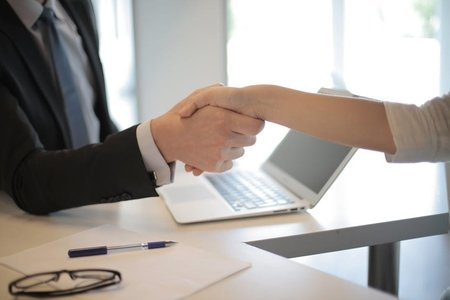 two people shaking hands business
