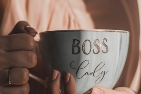 woman holding coffee cup saying boss lady