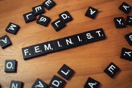 """Scrabble tiles spelling """"feminist"""""""
