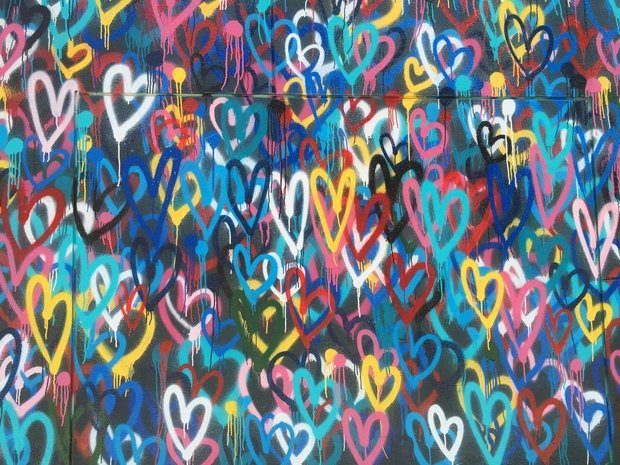 Colorful spray paint hearts wall