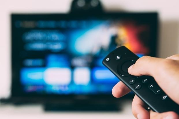 black tv remote and tv screen