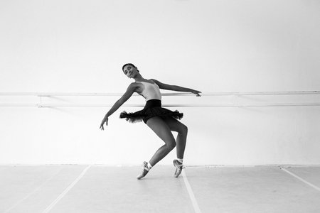 dancer in studio at the barre