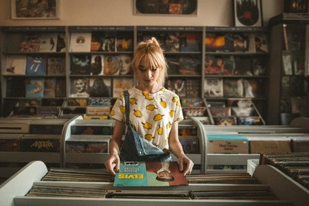 Girl looking at records