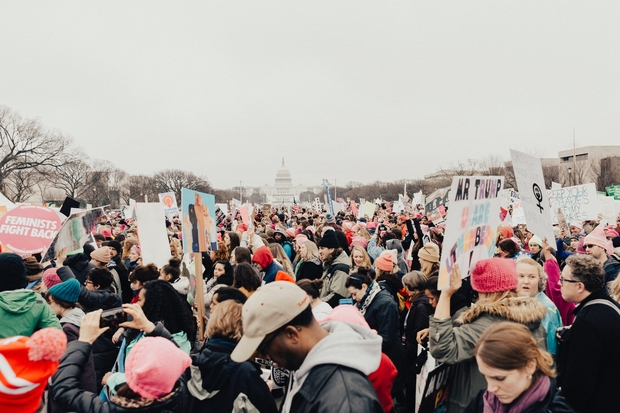A crowd of women protesting at a Women's March event