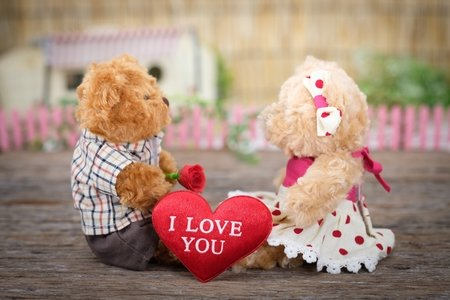 "two teddy bears with a heart that says ""i love you"" between them"