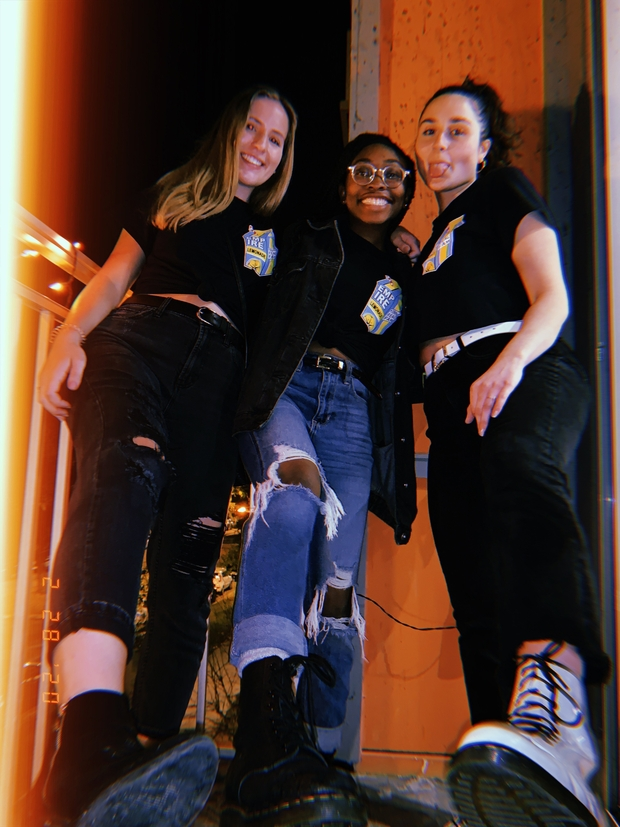3 friends posing with boots