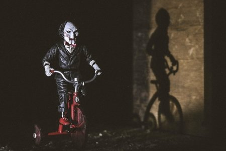 Jigsaw riding a bicycle