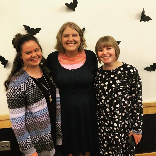 Three girls dressed nice, smiling