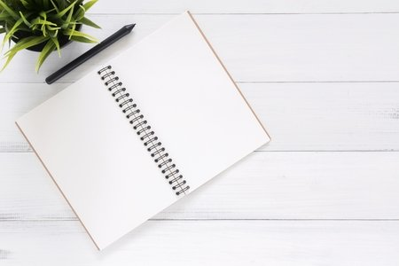 blank notebook with pencil