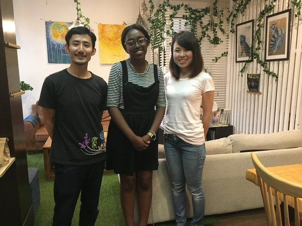 eboni standing with japanese guesthouse managers (my photo)