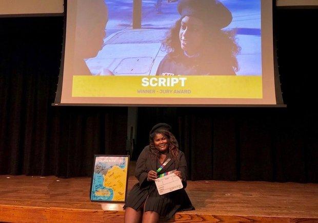 Brandy Star accepting CMF award for movie SCRIPT
