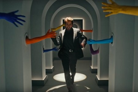 Screenshot of her music video where it shows Taylor Swift running down a hall