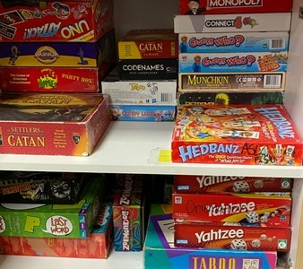 board games in a cabinet