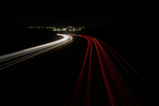 Night photo of cars on a freeway.