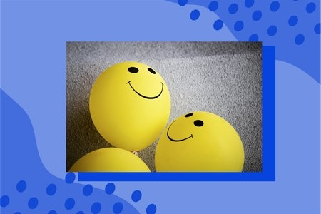 smiley face balloons on carpet