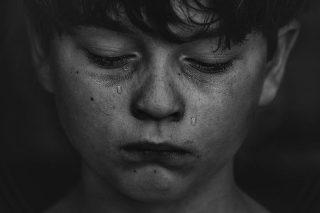 Boy cries in black and white