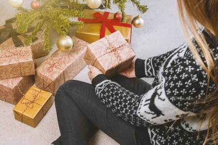 Image of girl with Christmas gifts