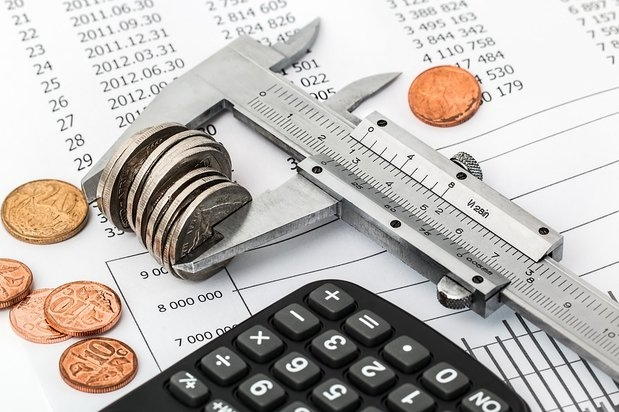 cash, calculator and coins