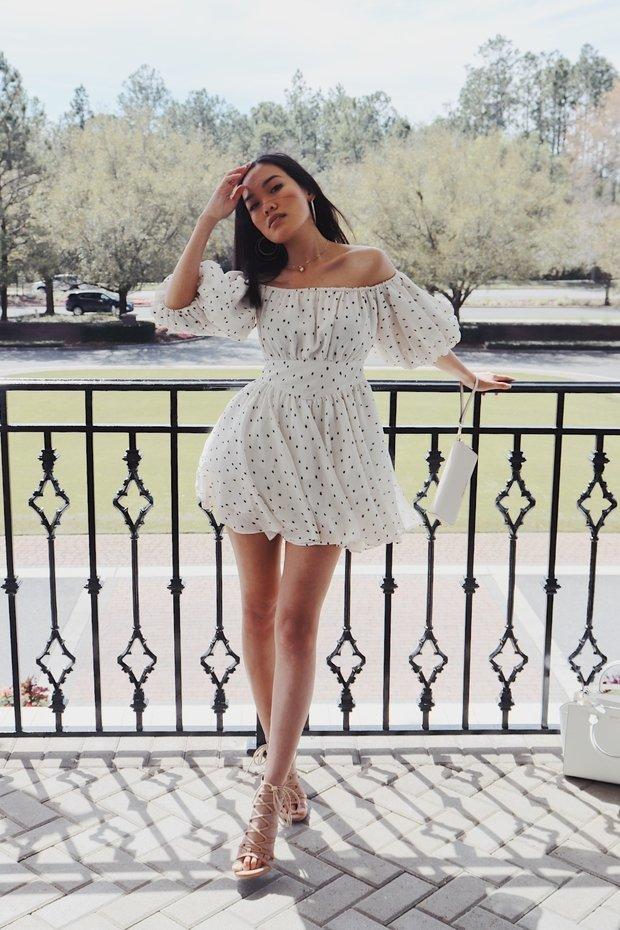 Girl posing in polka dot dress