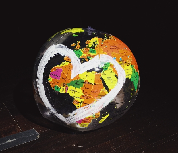 A globe with a heart drawn on it.